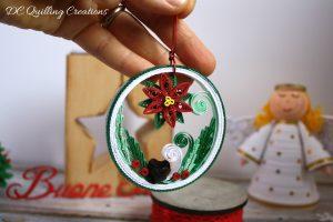 pallina natalizia con stella di natale quilling